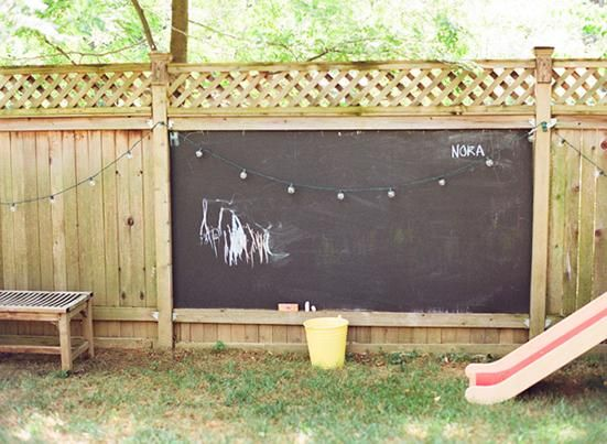 Chalkboard panel on a fence = ultimate canvas for kids