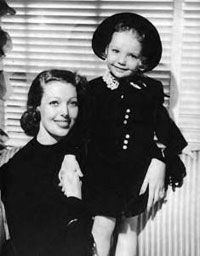 "Judy Lewis with her mother, Loretta Young...According to her autobiography Uncommon Knowledge, some people made fun of Judy because of the prominent ears she inherited from her father.   She states that at seven she had an operation to ""pin back"" her large ears and that her mother always had her wearing bonnets as a child. Over the years she had heard rumors that Clark Gable was her biological father since she looked so much like him."
