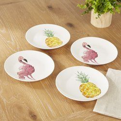 Painted flamingos and pineapples add a pop of playful color and design to these Tropicana-inspired dinner plates