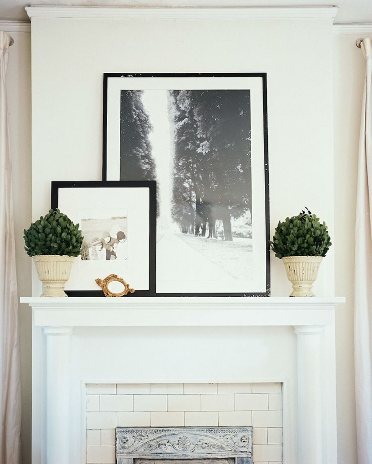 20 Great Fireplace Mantel Decorating Ideas | laurel home blog | via Lonny | simple mantel decorating perfect for summer | fireplace mantel decor | fireplace mantel styling | what to put on top of the fireplace mantel | fireplace mantel staging