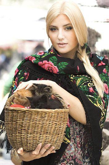 Russian girl in traditional scarf. Russian girls. Russian beauty. Blonde braid