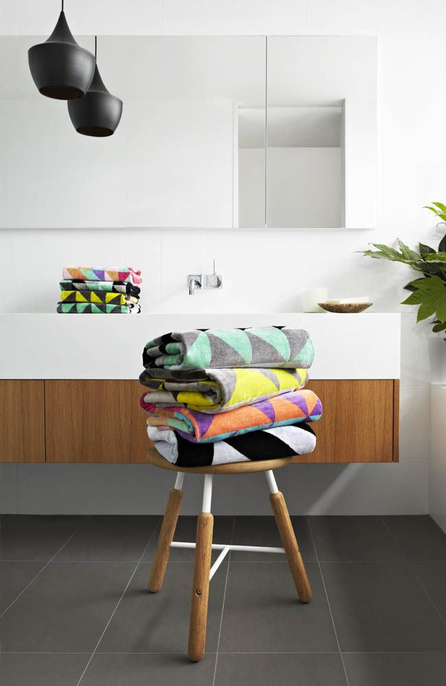 White and wood bathroom with bright towels