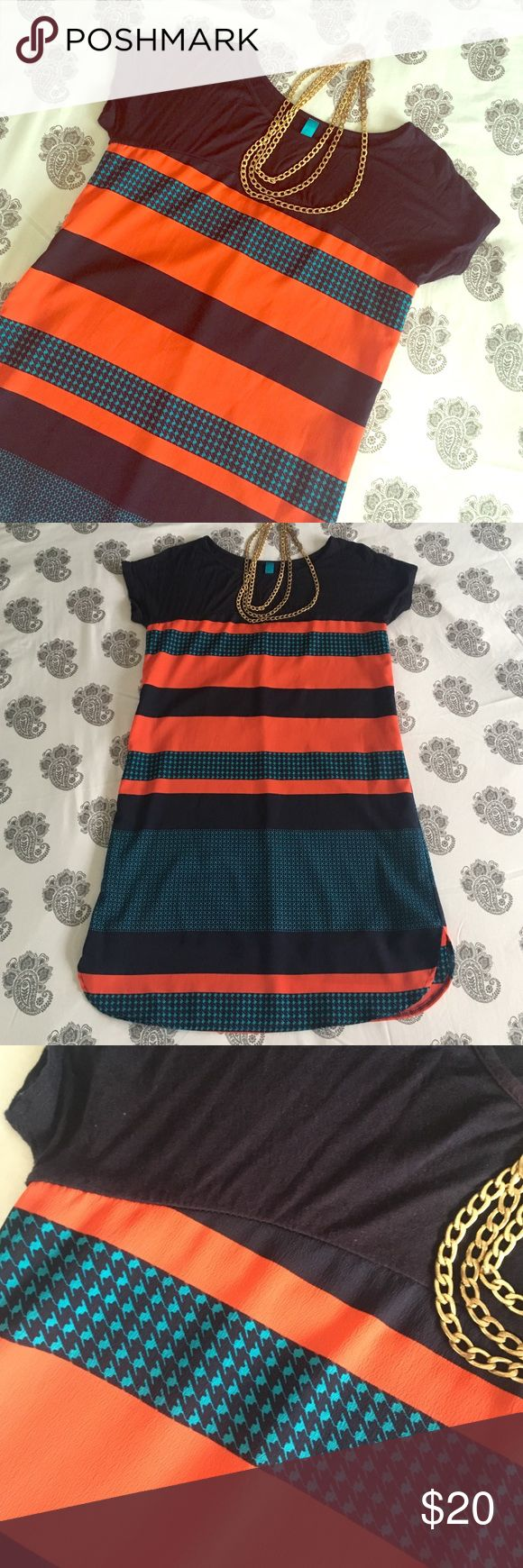 Shift dress Cap sleeve shift dress with graphic print. Tshirt material across yoke, rest of dress is polyester. Scallop detail at hem. Buttons design Francesca's Collections Dresses Mini