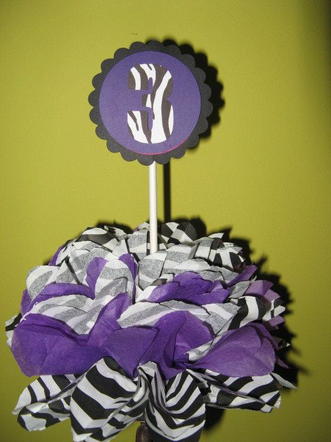Zebra centerpiece table decoration $8.00  Zebra and purple.  Other colors available.  Any age or letter can be put on the decoration.  Check our shop for matching favor bags, other table decorations, cupcake toppers, cupcake wrappers and banners.  All Custom made and personalized!