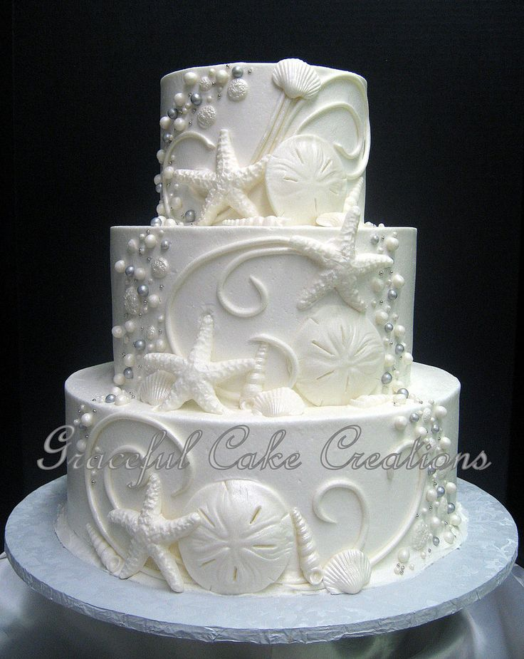 Elegant Beach Themed White Butter Cream Wedding Cake with Shells, Scrolls and Beads | by Graceful Cake Creations