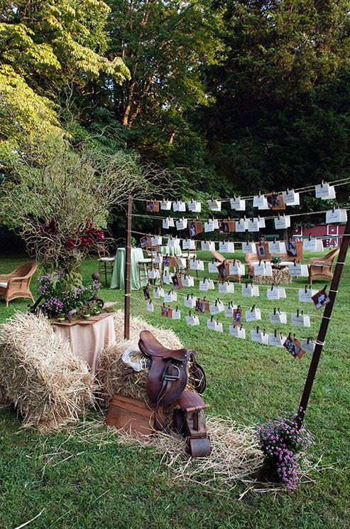 Hung on a makeshift clothesline, wedding place cards are a focal point in this southern outdoor wedding.