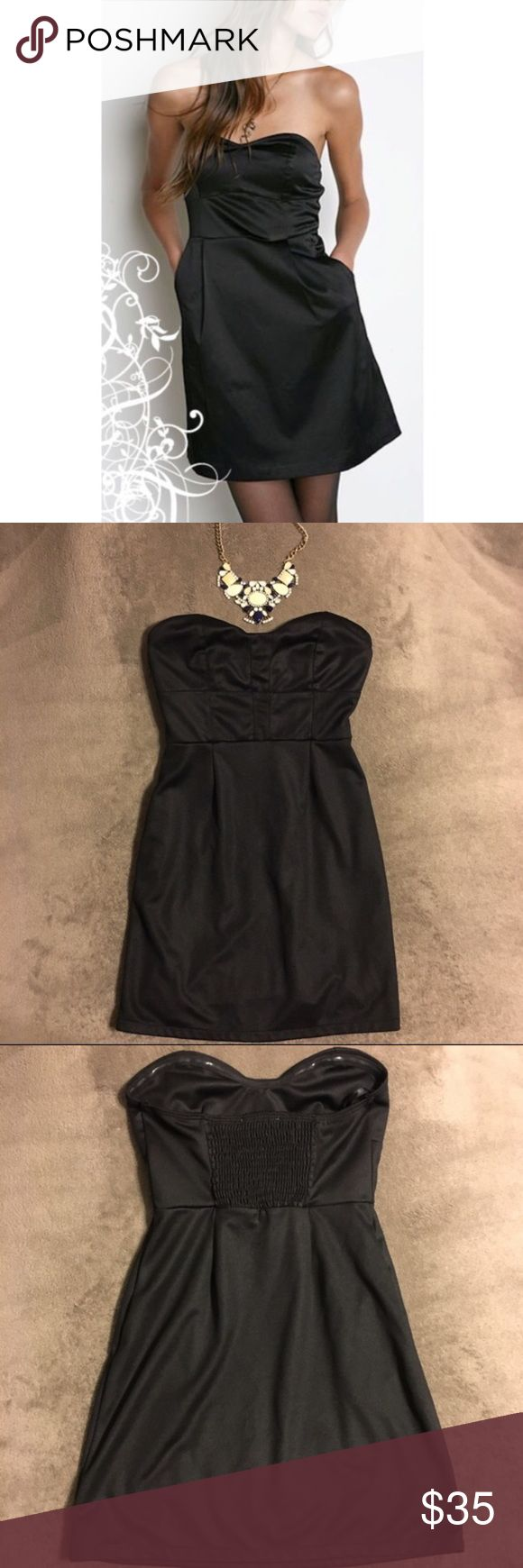 Silence + Noise Strapless Black Dress w/ Pockets Super cute black strapless dress from silence + noise, a brand carried by urban outfitters. worn once - excellent condition. Dress has an elastic back to fit to size, and a pocket on each side. 100% polyester. Necklace pictured is not included or for sale. Perfect dress for any occasion! Urban Outfitters Dresses Strapless