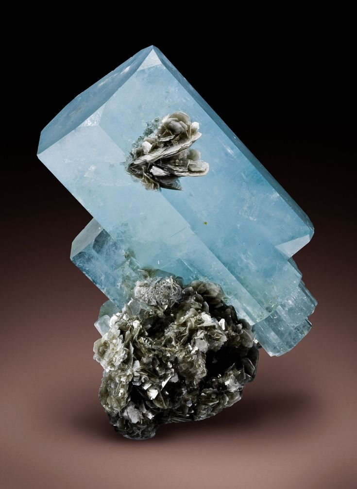 Aquamarine on Muscovite:Aquamarine is a stone of courage.  Its calming energies reduce stress and quiet the mind.  It can invoke tolerance of others and overcomes judgmentalism, giving support to those overwhelmed by responsibility.
