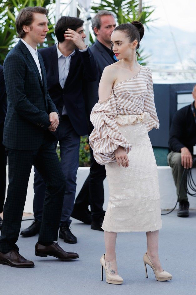 The Best Celebrity Style From Cannes Film Festival 2017: Cannes Film Festival known for princess-like gowns and sexy, thigh-high slits, and this year, there's more of the same—with even more pouf and revealing details. -- Lily Collins ruffled Johanna Ortiz | coveteur.com