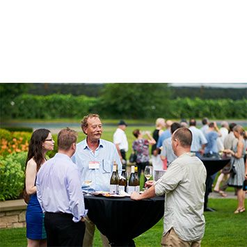 """Guests sharing time with winemakers - Jean-Francois Bourdy (centre) of les Caves Jean Bourdy in Jura, France.  """"8 Chefs. 8 Grills."""" - the kick-off event at Trius Winery at Hilldebrand."""