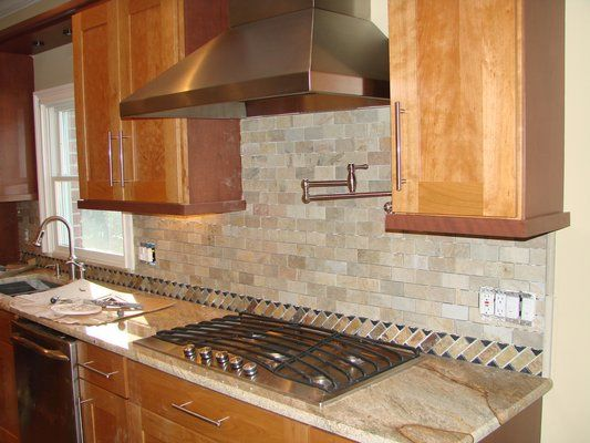 kitchen back splash in natural stone brick pattern