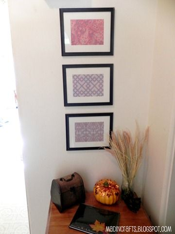 Simple and inexpensive wall filler - framed scrapbook paper.