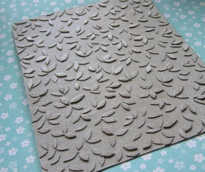 Make your own embossing plate out of old cereal boxes!