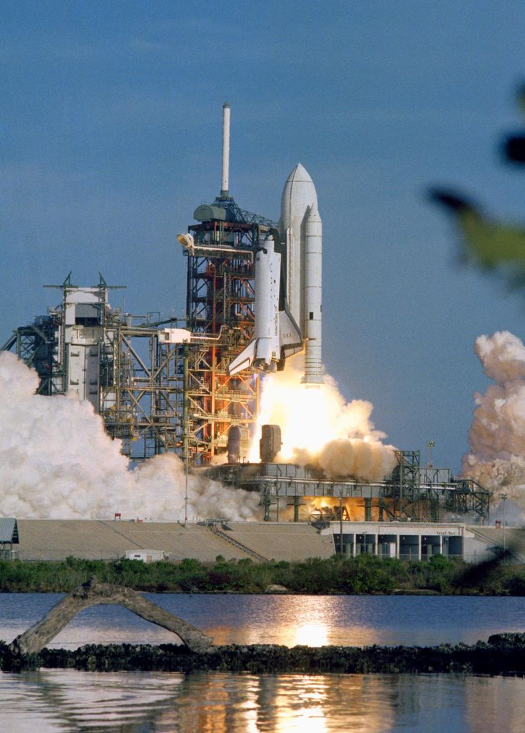 S81-30463 (12 April 1981) --- The space shuttle Columbia rises off Pad 39A a few seconds past 7 a.m. (EST) on April 12, 1981. Onboard, astronauts John W. Young, STS-1 commander, and Robert L. Crippen, pilot, head toward an Earth-orbital mission which represents the beginning of a new era in space transportation. Thousands of persons were in the area to view the historic launch. Photo credit: NASA.