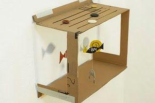 Pequeña pecera. Juguetes de cartón. Como eleborar juguetes con materiales reciclados.