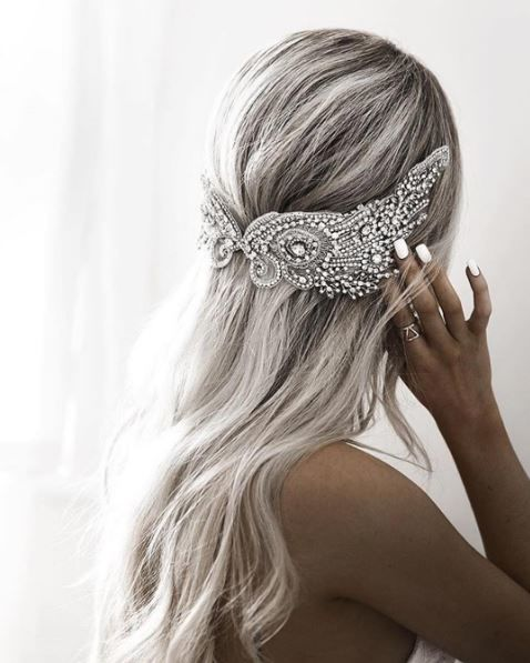 Bright White Wedding Manicure: With a cool color palette at your wedding, white nail polish makes the perfect addition to your wedding nails and bridal look - this bride's gray hair and sparkly bridal headpiece looks stunning with a white manicure.