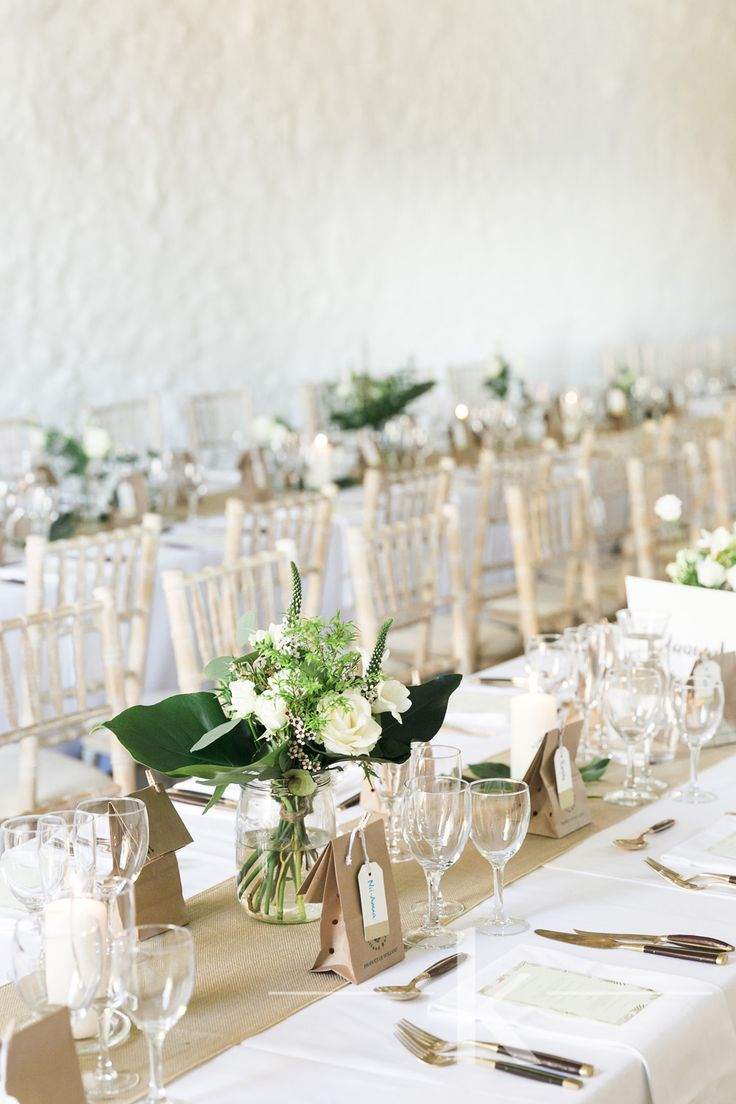 All natural table scape with strong foliage and simple white flowers