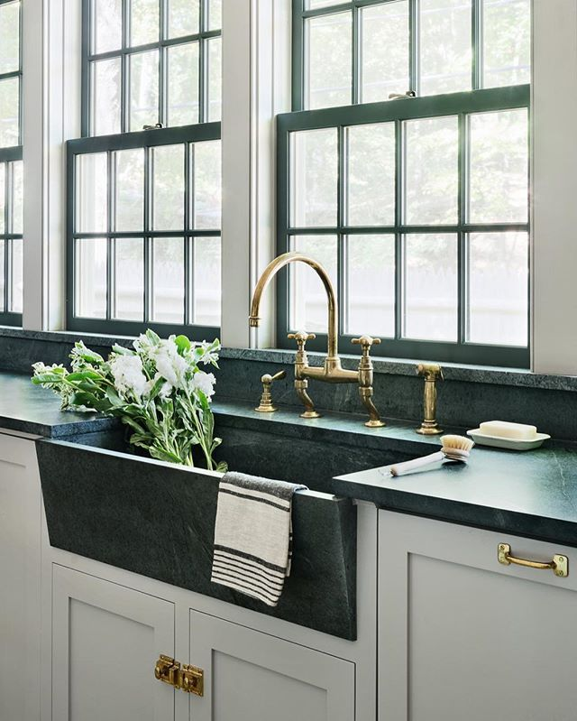 I'm in love with these dark green countertops and sink! The 90s are officially back, friends. Killer kitchen by @rafechurchill {you can see the rest of our top pins from the week on the blog today}