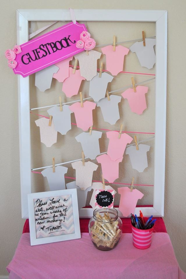 Guestbook Onesies-  Cardstock, ClothesPins, Ribbon, Frame, Onesie Puncher.