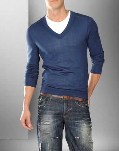 Casual blue jeans and v-neck sweater