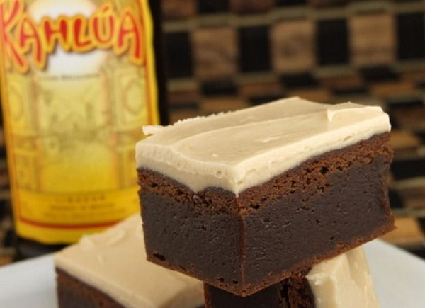 Kahlua Brownies  BROWNIES:  2 1/2 cups all-purpose flour  1/2 teaspoon baking powder  1 teaspoon salt  1 cup unsalted butter  2 cups semi-sweet chocolate chips  1 1/2 cups light brown sugar  2 large eggs  1/2 cup + 2 Tablespoons Kahlua (or another coffee liqueur), divided    ICING:  1/4 cup (1/2 stick) butter  2 Tablespoons kahlua  1 Tablespoon whipping cream  2 1/4 cups powdered sugar