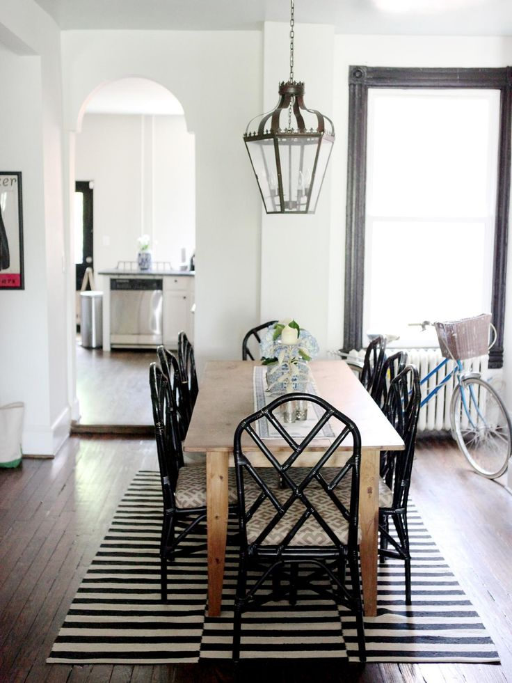 Chippendale chairs are mixed with a custom farm table for an eclectic, vintage vibe in this black and white dining room.