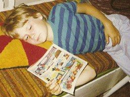 Young Tuomas Holopainen reading Aku Ankka (Donald Duck) comics.