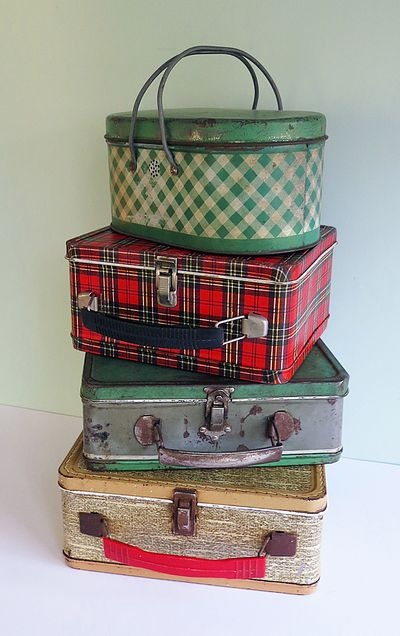 lunch boxes...I had the red plaid one...it was a hand-me-down and I was the 4th one to use it!!  Still have it!! :D