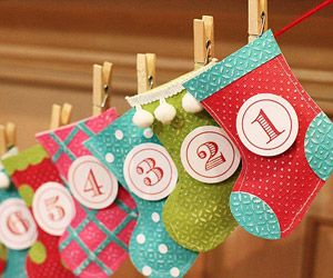 A garland made of 24 hand-cut stockings makes a quick and fun project for you and your children. Adhere two stocking shapes together, and pad the inside of each stocking with cotton balls to give it a fuller look but allow room to hold a treat or note. Then use clothespins to attach the stocking to a length of yarn.