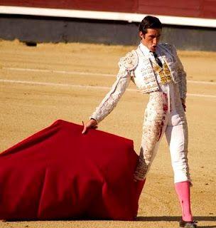 Emilio's last corrida, wearing white to display the blood.