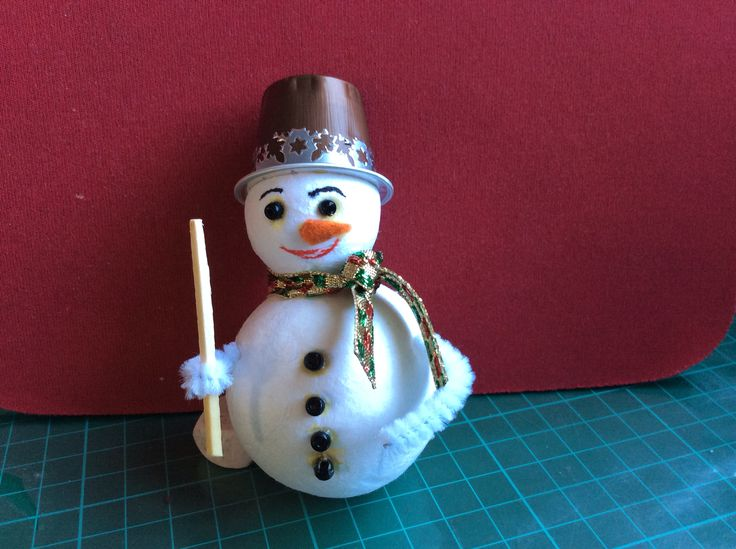 Snowman made of paper balls and Nespresso capsule