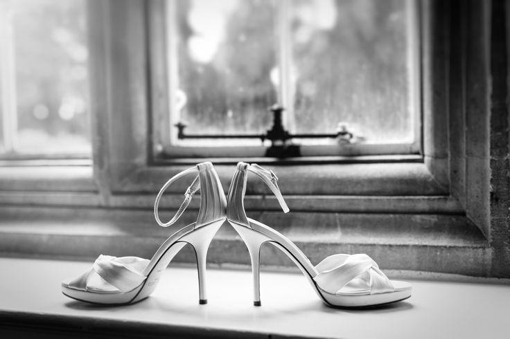 Beautiful ivory Jimmy Choos make the perfect bridal shoe. Photo by Benjamin Stuart Photography #weddingphotography #jimmychoo #bridalshoes #bride #weddingday