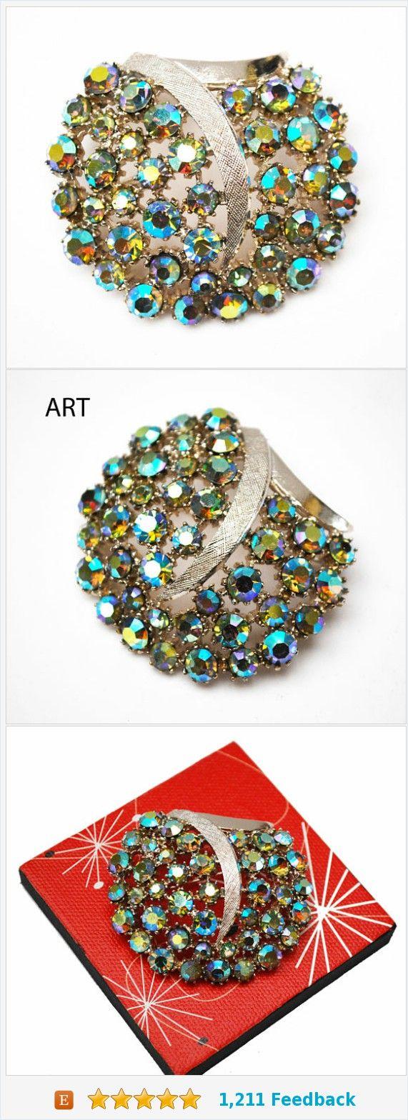 Rhinestone Brooch - Art Mode signed -Aurora Borealis Rhinestone - silver Swirl - Domed - Large Mid Century Pin https://www.etsy.com/serendipitytreasure/listing/557815318/rhinestone-brooch-art-mode-signed-aurora?ref=listing_published_alert