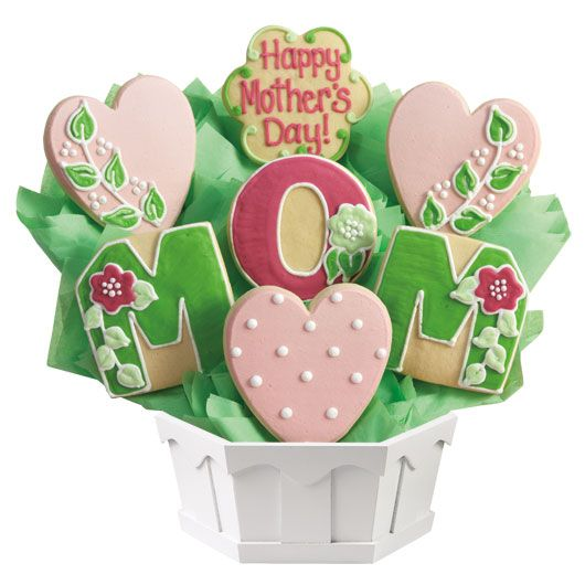 Treat your mother to a gift that tastes as good as it looks. Hand decorated cookies for Mother's Day!