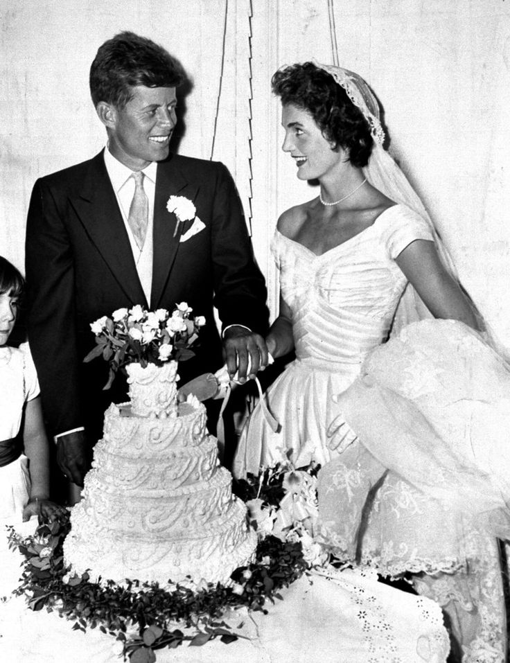 President John F. Kennedy with wife Jacqueline cut the cake at their wedding in Newport, Rhode Island.