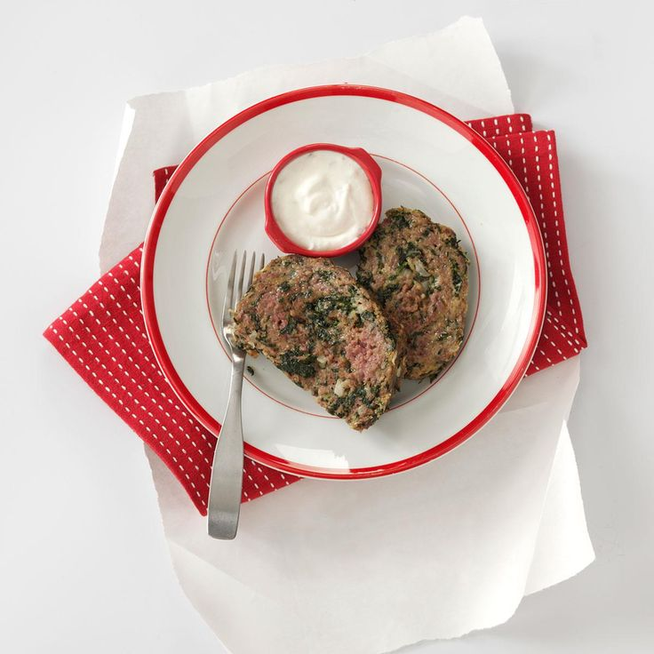 Gyro Meat Loaf with Tzatziki Sauce Recipe -A spin on a classic meat loaf, I love this because I can sneak spinach in on my meat-and-potatoes family. Serve it with Greek-style potatoes or a Greek salad. I also get to make a whole other meal the next night with the leftovers—gyros. —Mandy Rivers, Lexington, South Carolina