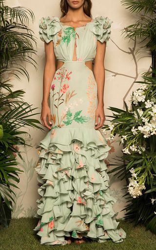 This **Johanna Ortiz** dress features ruffled shoulder details and a keyhole at the bodice.
