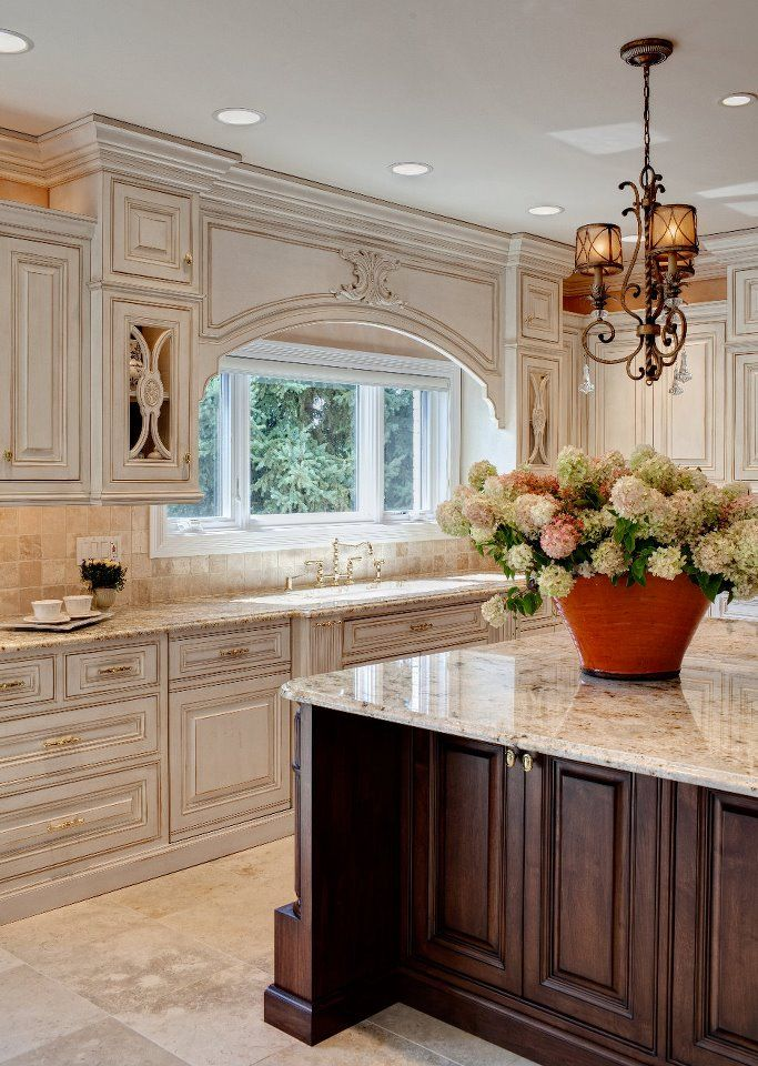 Like the stain on island and light colored cabinets and counter tops