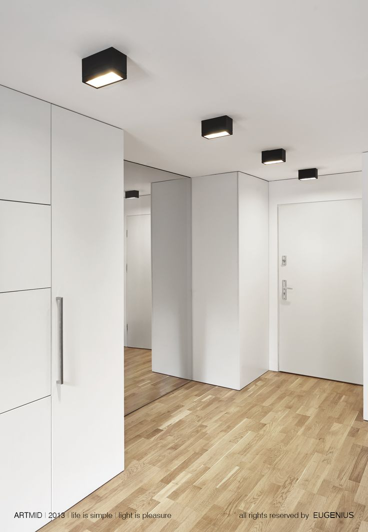 EUGENIUS. modern lighting fixtures, architectural interior lamps for home and office. simple white walls and wooden floor.