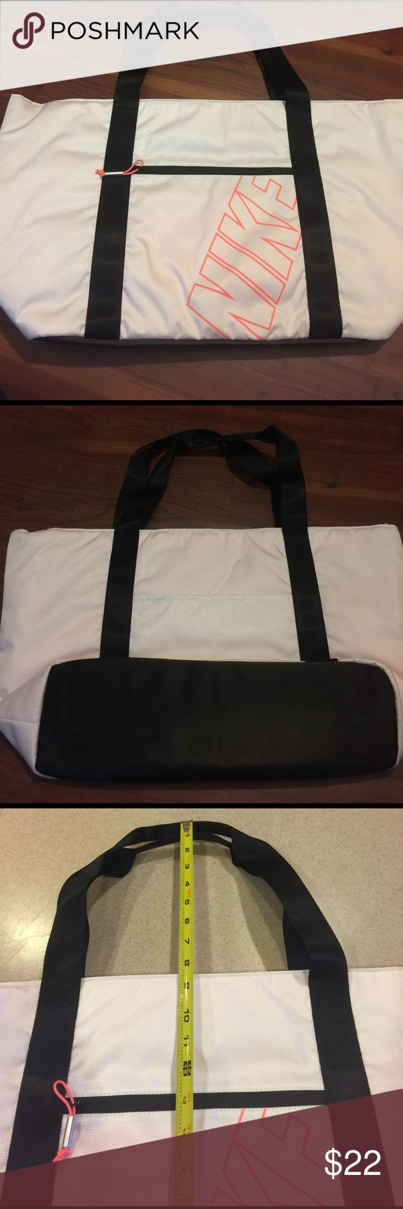 Nike Large Tote Bag Large White Nike Tote Bag . Has zippered pocket on inside . Small Zippered pocket on outside.  22 wide and 13.5 tall Nike Bags Totes