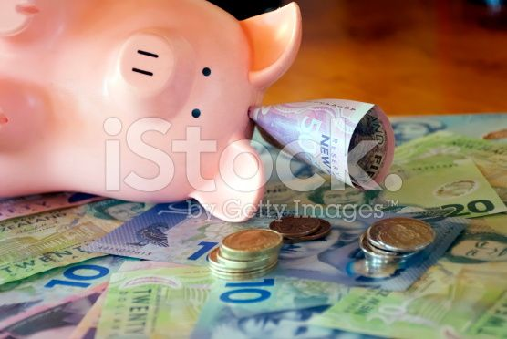 New Zealand Money (NZD); Dollars & Coins with a Piggy Bank royalty-free stock photo