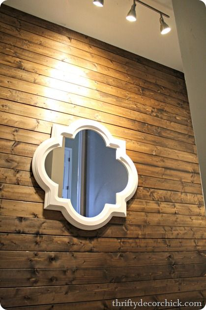 Beautiful #HomeGoods mirror on a wood planked wall