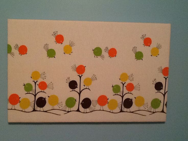 Wall art for the baby room made from a vintage apron pattern kit