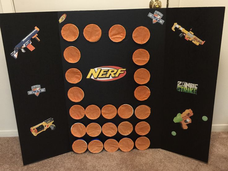 Nerf punch game.  Simple to make and cheap.  Folding poster board, solo cups, candy or prize, and tissue paper.  The kids shot their nerf gun and busted through the tissue paper.  Which ever cup they broke through, they got the prize inside.  All cups had a couple of pieces of candy and a few had tickets for prizes.