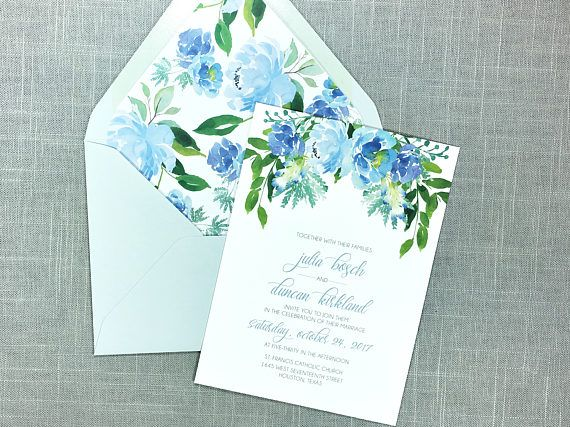 Dusty blue wedding invitations with greenery and elegant floral details. High-quality printed invites with added touches like matching envelope liners and belly bands make the Julia Suite a gorgeous decision for your wedding suite!