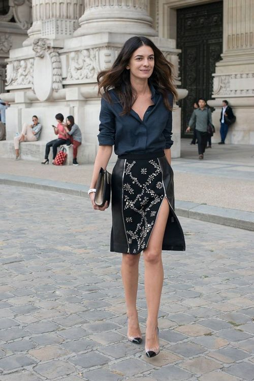 Street style | Spring work attire >>> Not sure of the city, but this is perfect, from the print skirt to the spectator mid-heels.