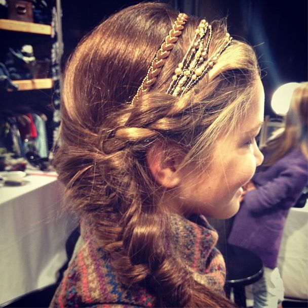 Finished Ralph Lauren Girls hair look: Braid worked into a side fishtail, topped off with layers of beaded headbands
