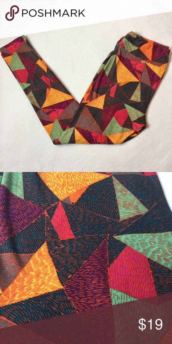 Lularoe TC Leggings in Geometric Print Worn once and washed as per the care instructions this is a pair of Lularoe leggings in size TC with a bright geometric print and browns oranges reds and greens. From a smoke free home LuLaRoe Pants Leggings