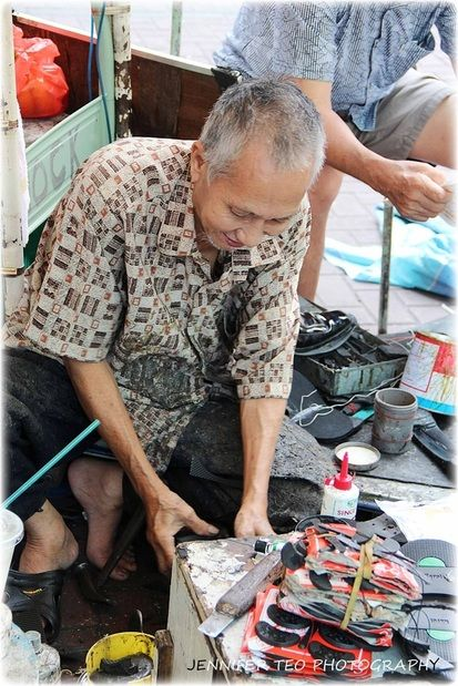 A Vanishing Trade in Singapore - Street Cobbling, To Be Remembered