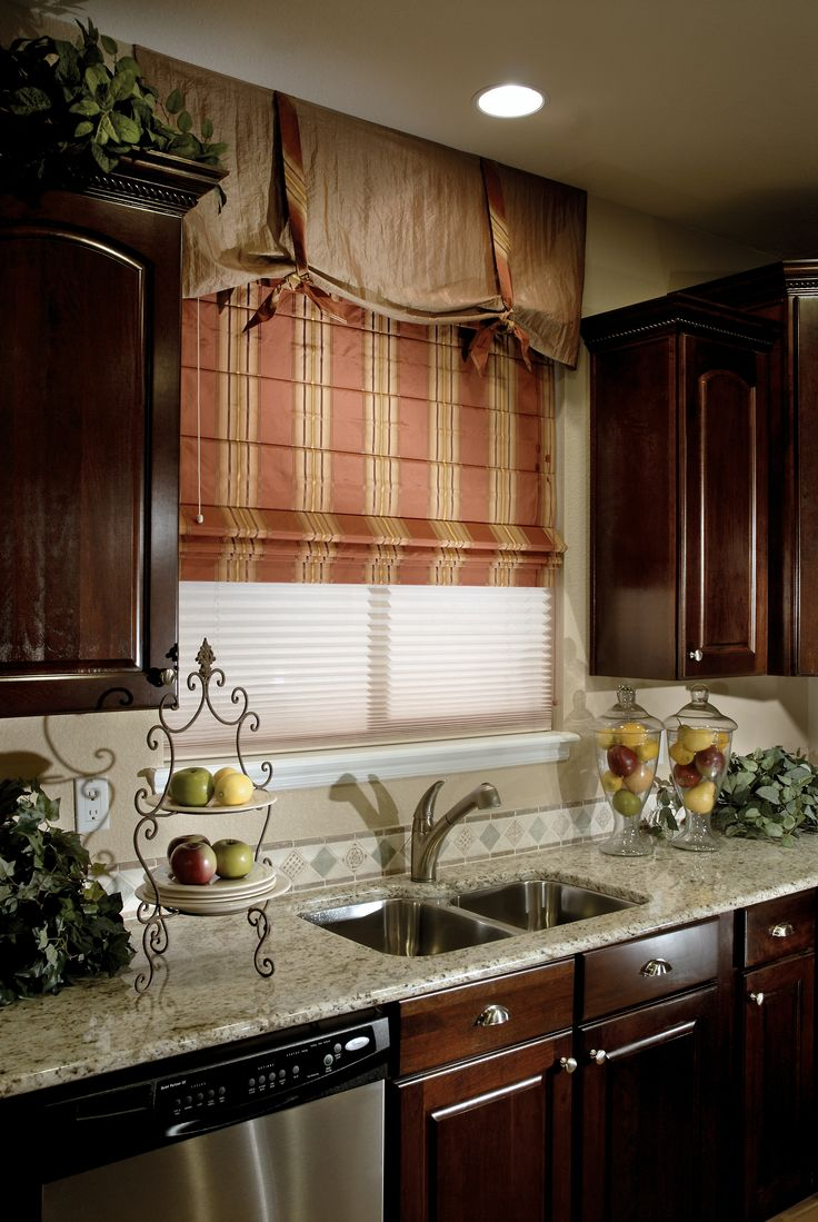 ROMAN SHADES Custom Made Volari Style Volari roman blind with the Sheer Vue light filtering option, and Valance allows beautiful light in the kitchen. Horizontal stabilizers are incorporated into the visual design, showing a repeated tuck pleat, adding dimension to this window dressing. The permanent fixed pleats add visual integrity by interrupting the pattern. Different fabrics will give dimension and depth. Visit us on our site for more kitchen ideas.